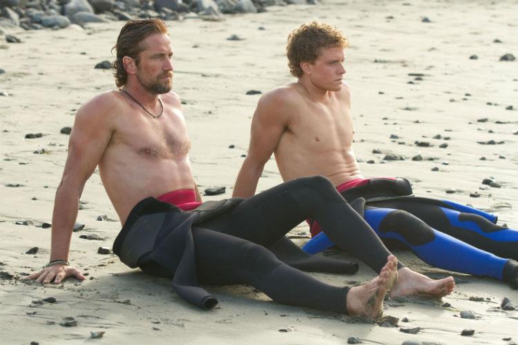 Gerard Butler and Jonny Weston in 'Chasing Mavericks' (20th Century Fox)