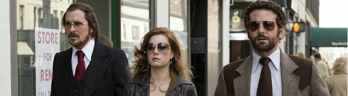 Christian Bale, Amy Adams, and Bradley Cooper in 'American Hustle'